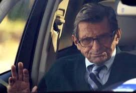 Penn State football coach Joe Paterno arrives home Wednesday after