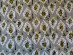 Hanging on the wall in the lounge is a delightful stylised leaf patterned fabric by Joan Charnley  a local designer who studied at Manchester School of Art     Elmet Farmhouse
