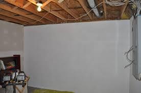 applying finishing touches to concrete foundation walls buildipedia