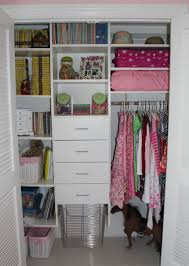 white stained wooden closet with shelves and drawer plus silver