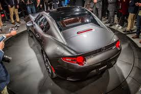 mazda mx series 2017 mazda mx 5 miata rf on stage rear side view from above