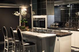 black cabinets double wall ovens gray island with concrete