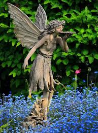 how to use statues and sculptures to make your garden stand out