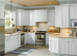 Kitchen Cabinet Colors 2014 by Kitchen Cabinets White Cabinets Black Countertops Wood Floors