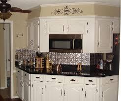 white fabulous white kitchen cabinet and tin backsplash with