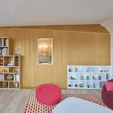 clutter concealed within wooden walls inside french apartment