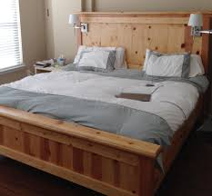 low profile light brown wooden bed frame with high head board also low profile light brown wooden bed frame with high head board also lamps on