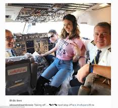 Lucky chaps  The plane     s pilots got a special cockpit visit from Alessandra Ambrosio