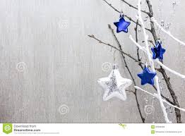Awards And Decorations Branch by Christmas Decoration With Stars And Bare Tree Branch Stock Photo
