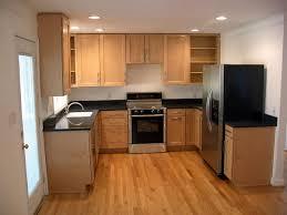 u shaped kitchen with peninsula quartz countertops pull out trash