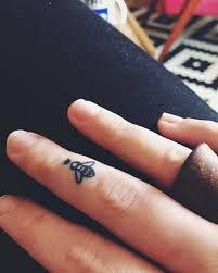 cool little tattoo 15 tiny tattoo ideas that are beyond dainty finger tattoo and