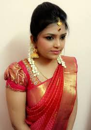 traditional southern indian bride wearing bridal silk saree and jewellery enement look makeup and