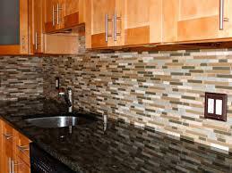 honey oak kitchen cabinets with black countertops pearl or ubatuba