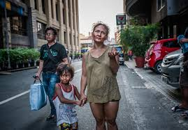 Philippines  The inequalities awaiting Rodrigo Duterte   Al     Al Jazeera A homeless woman begs for money with her son on Mabini Street in Malate  Manila   James Whitlow Delano Al Jazeera