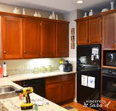 How To Paint Kitchen Cabinets Like A Pro Why I Repainted My Chalk Painted Cabinets Sincerely Sara D