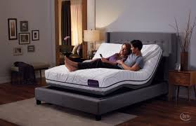 why adjustable beds are the future smitty s fine furniture young couple enjoys the adjustable bed and mattress from serta in canada