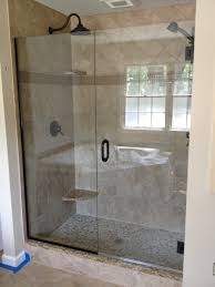 bathroom frameless shower doors with black handle matched with