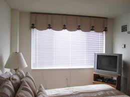 beautiful custom large window treatments with long curtain in