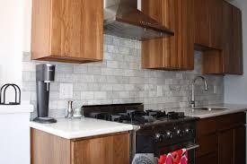 backsplash tile designs for kitchens rectangular light grey tile kitchen backsplash make it look so