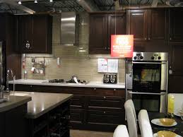 kitchen with white cabinets and dark countertops hottest home design