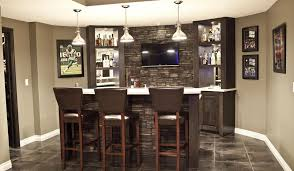 stone wet bar in basement with flat screen tv pioneering
