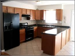 kitchen cabinets white cabinets dark grey island small kitchen