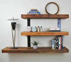 Hanging Bookshelves Ikea by Hanging Shelf With Books And Three White Ceramic Advice For Your