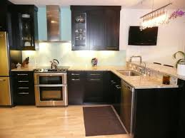 Dark Kitchen Cabinets With Backsplash Dark Kitchen Cabinets With Light Granite Countertops Outofhome And
