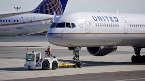 United Airline Baggage by United Airlines Boeing 757 224 Registered N74856 Pushing Back At