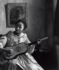 A Lady Playing the Guitar