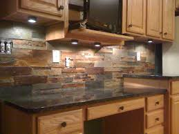 this natural slate tile backsplash is shown with uba tuba granite