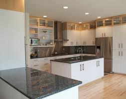 several great pairings for white kitchens with granite countertops