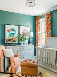 blue and orange boy nursery with gray paneled crib transitional