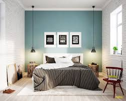 blue and brown bedroom with oak furniture throughout accent wall