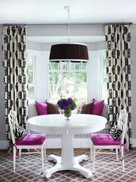 purple upholstered chair brown cushions and pendant lights round