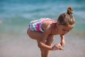 Little girls bent over|iStock