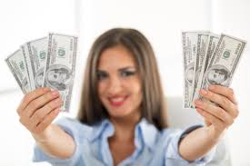 Kick Off      With   College Scholarships   The Scholarship Coach     Happy successful Businesswoman in the office holding money  Focus on the money