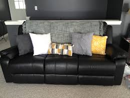 cheap decorative pillows for sofa lighten up a black leather couch with bright pillows and a throw