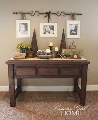 hang family pictures from a curtain rod also want this table