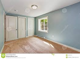 light blue bedroom with closets stock photo image 45626743