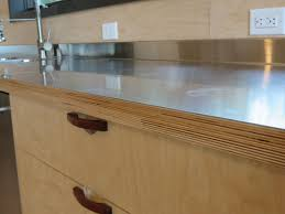 stainless steel laminated to baltic birch woodweb s laminating birch plywood reminds me of leather pulls for drawers kitchen cabinets plywood cabinets