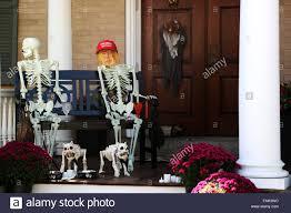 halloween decorations skeletons a donald trump mask on a halloween skeleton decoration outside a