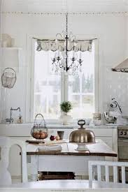 White Shabby Chic Chandelier by Shabby Chic White Kitchen With Chandelier Lighting Fixtures