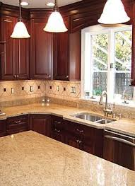 cherry cabinets in kitchen kashmir white granite with off white subway tiles and cherry