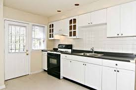 white kitchen with black countertops black countertop and white