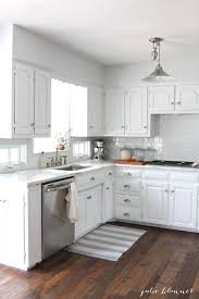 white kitchen with granite counters remarkable home design