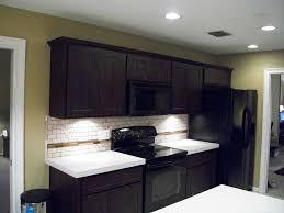 Dark Kitchen Cabinets With Backsplash Kitchens With Dark Cabinets And Travertine Floors Inviting Home Design