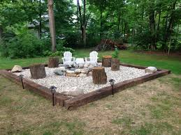 How To Make A Fire Pit In Backyard by Fire Pit Rail Road Ties River Rock And A Ring Simple And Cheap