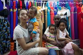 Afro Chinese marriages boom in Guangzhou  but will it be      til     South China Morning Post Guinean trader Cellou with his wife  Cherry  and their children  Photo  Robin Fall