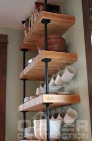 reclaimed industrial butcher block shelves suspended with black